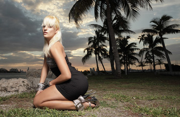 Woman posing on her knees