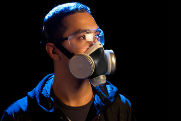 A man in a respirator and glasses