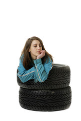 young woman resting in care tires