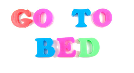go to bed written in fridge magnets