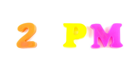 2 pm written in fridge magnets on white background