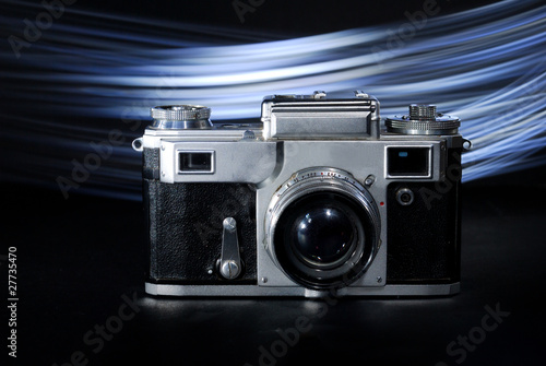 old camera with lens made in Russia on black artistic background