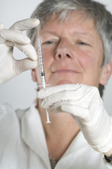 Female doctor proparing for injection