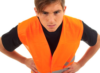 furious, angry young man in orange protective waiscoat