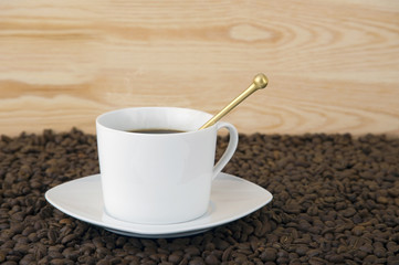 cup of coffee with teaspoon