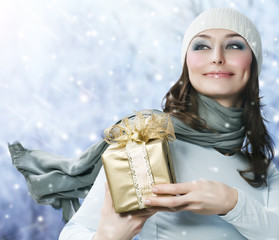 Beautiful Happy Girl with Christmas Gift.Snow