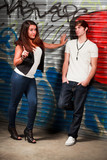 Young Couple in Urban Lifestyle with a Graffiti Background poster