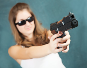 girl aiming a black gun
