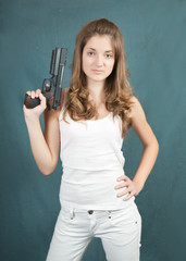young woman posing with gun