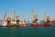 Leinwanddruck Bild - The trading seaport with cranes, cargoes and ship