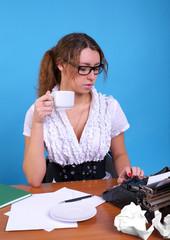 Female author with vintage typewriter
