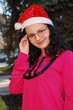YOUNG LADY WITH SANTA CLAUS HAT