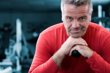 Satisfied mature man at gym