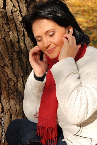 listening to the music outside near a tree (closed eyes)
