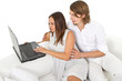 Young european couple surfing the web at home