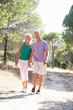 Senior couple, holding hands, walking in park