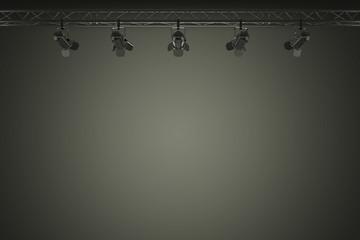 dark background lit by stage lights