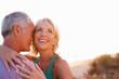 Romantic Senior Couple in love at sunset