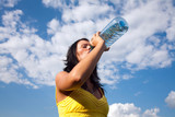 Young thirsty girl drinking water from a bottle poster