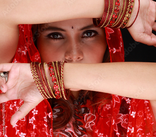 Beautiful Eastern girl with black veil on face