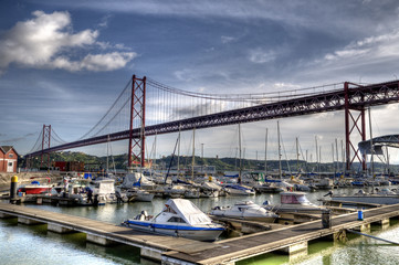 Boats by The 25 de Abril Bridge, Lisbon, Portugal