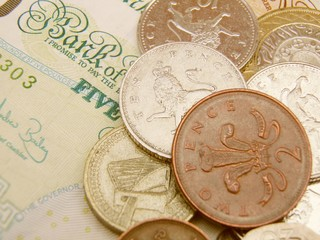 British Sterling pound currency banknotes and coins