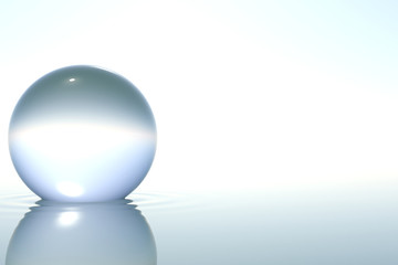 Zen glass sphere in water on white background