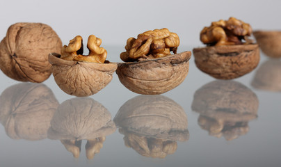 Group of walnuts with reflection