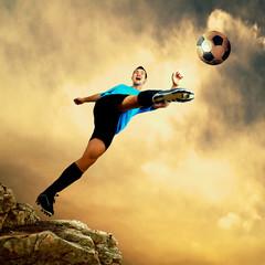 Footballer on the top of mountain