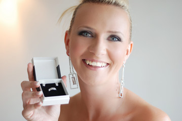 Beautiful girl with jewelry gift