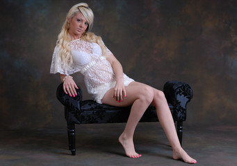 Pretty young woman sat on lounger
