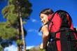 Woman hiking looking at view