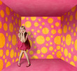 surprised blonde in pink dress in pink room