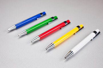 Set of  pens on table