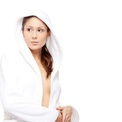 Young beautiful woman in bathrobe