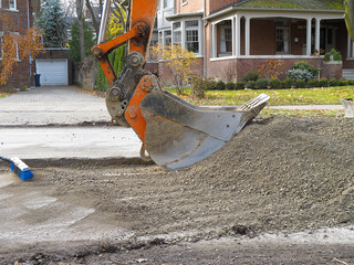Backhoe on residential street