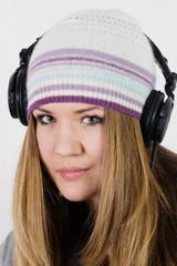 Young pretty girl in headphones
