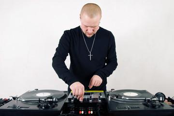 Bold hip-hop DJ mixing vinyl