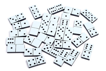 Domino pieces laying on white background randomly