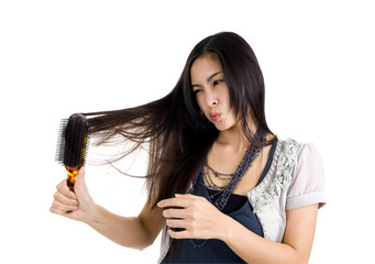 woman brushing her hair