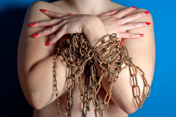 Girl front view with chain and padlock on blue background with r