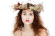 beautiful young woman in natural wreath over white