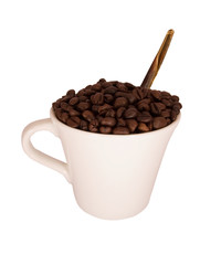 cup with coffee grains and spoon against white background