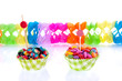 colorful little candy in  modern cupake molds with party streame