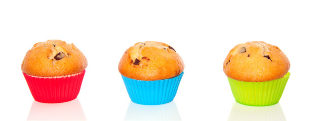 three muffins with chocolate abreast in colorful cupcake-molds