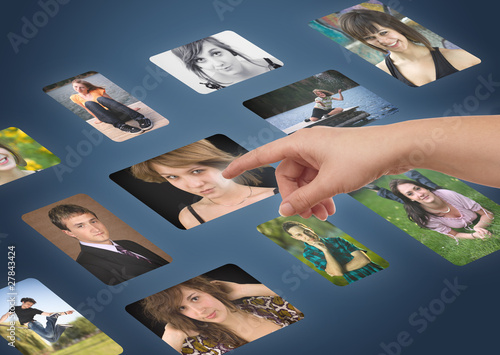 Man hand choosing photos