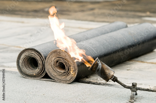 tar roofing felt roll and blowpipe with flame