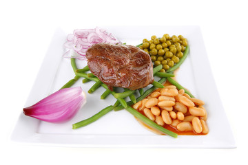 fresh grilled meat medalion on beans