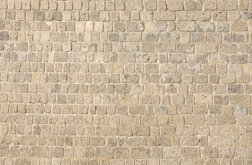 Bahrain fort wall with texture formed by limestone blocks