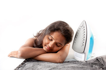 Indian girl sleeping  and electric steam iron